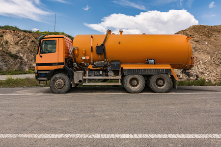 Truck with water tank intended for construction