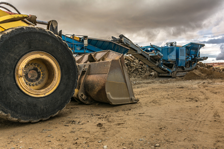 Heavy machinery for stone transport and gravel transformation for construction of a road