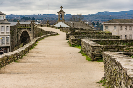 The Roman wall of Lugo surrounds the historic center of the Galician city of Lugo in the province of the same name in Spain Archivio Fotografico