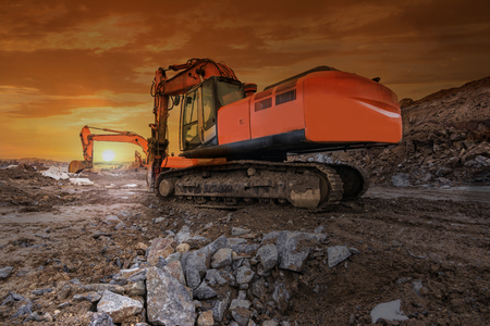 Heavy hydraulic machinery in construction works at dawn