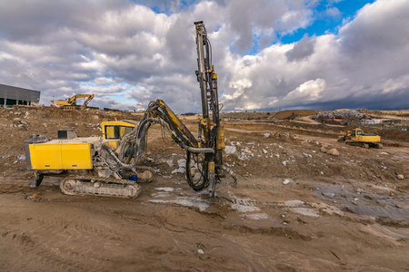 Drilling machine and excavators in a workplace