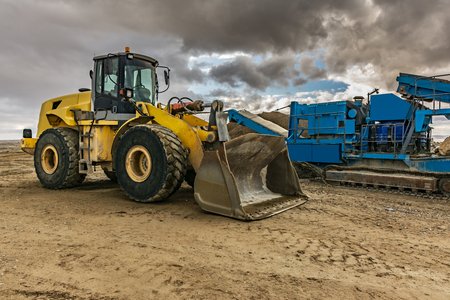 Excavator and machinery in an outdoor mine Stock Photo
