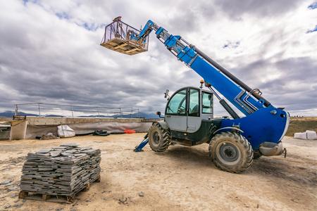 Forklift on a construction site, preparing to raise construction parts Reklamní fotografie
