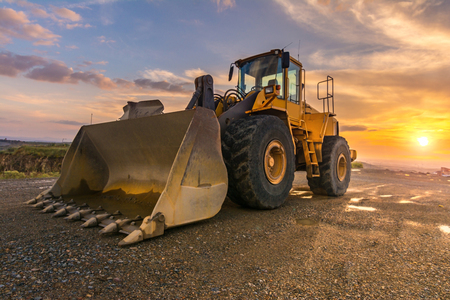 Hydraulic hammer and excavator building a road Stock Photo