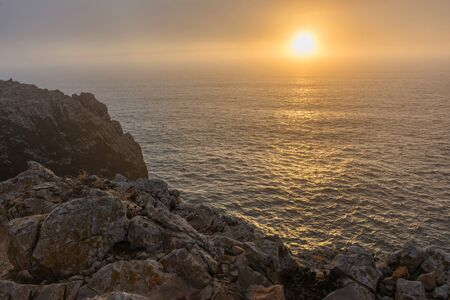 Sunset at the cape of Sant Vicente (in Portuguese Cabo de São Vicente) located in the southwestern tip of Portugal. It is located near Sagres (Portugal)
