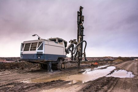 Industrial drilling machine in the construction of a road