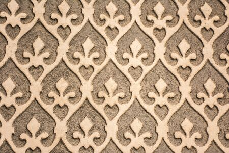 Traditional decorative pattern of the facades of the houses in the historic Jewish quarter of Segovia. Also called sgraffito (Spain) 免版税图像