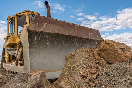 Excavator moving earth in a construction site