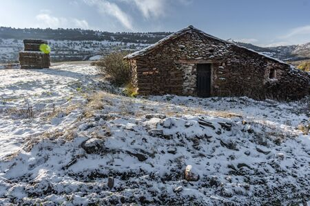 Stone stables to shelter cattle in winter in the Grade of the Peak in the Sierra de Ayllon in the province of Segovia (Spain) 写真素材