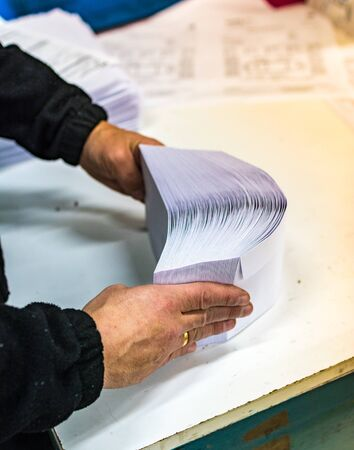 Manipulating envelopes for mailing in a printing press
