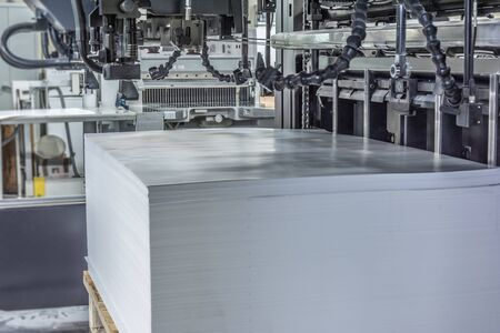 Input or load of paper in an offset printing machine measures 72/102 Stock Photo