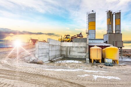 Quarry for the extraction of sand and stone, its transformation into gravel and cement manufacturing Stock Photo