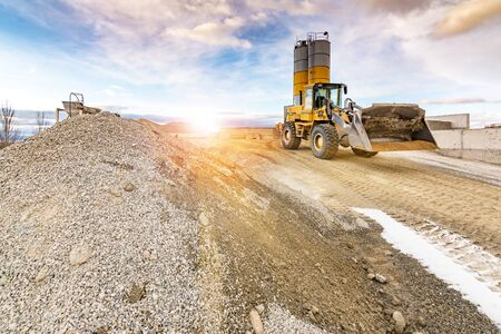 Quarry for the extraction of sand and stone, its transformation into gravel and cement manufacturing