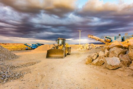 Excavator and stone crusher in a quarry