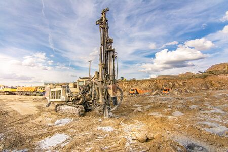 Professional drilling rig doing a geotechnical study of the terrain 写真素材