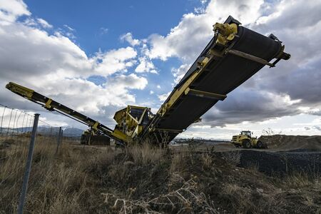 Heavy machinery for processing rock and stone in a quarry Stock Photo