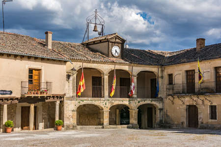Town hall of the medieval town of Pedraza and its castle in the province of Segovia (Spain)