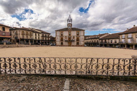 RIAZA, SEGOVIA, SPAIN - JUNE 16, 2020: Plaza Mayor de Riaza with the Town Hall, a place near the Ayllon mountains