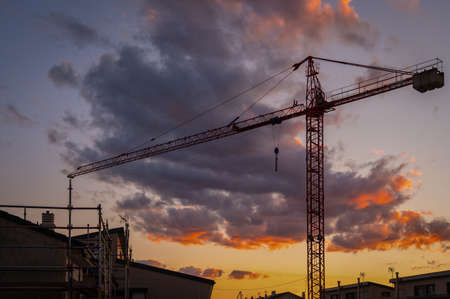 Silhouette of a crane at a construction site at sunset Imagens