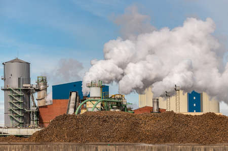 Sugar production factory with beets in the foreground Imagens