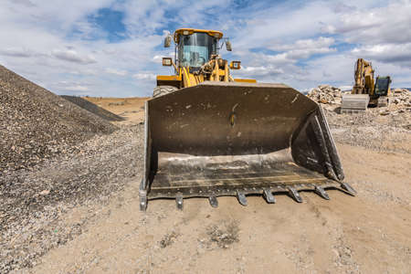 An excavator in a stone turning quarry into gravel