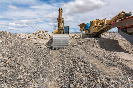 Excavator and machine to transform stone and rock into gravel