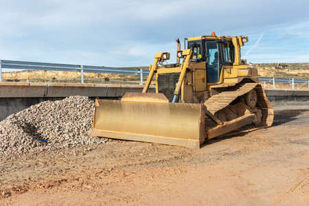 Excavator making earth movements for the construction of a road