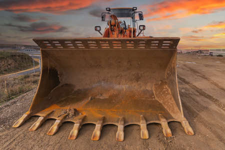 Excavator building a road in a site construction Imagens