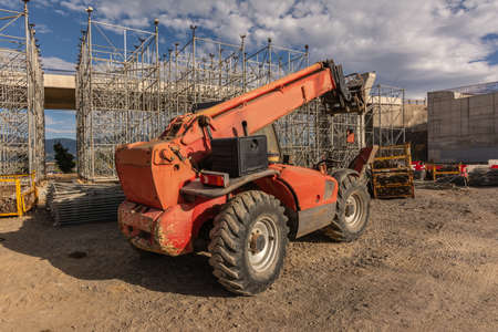 Forklift on a construction site, preparing to raise construction parts Stock fotó