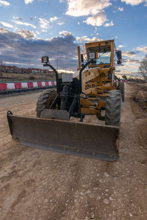 Excavator at a construction site, performing earth moving work