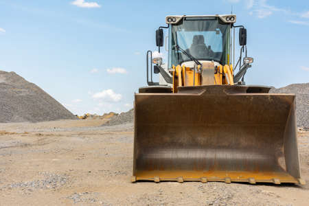 Excavator at a construction site in the extraction of stone and rock Stock fotó