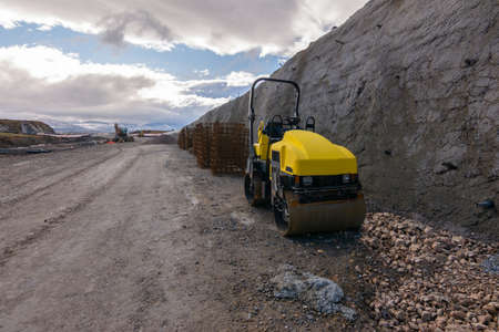 A mini steamroller at a road construction site
