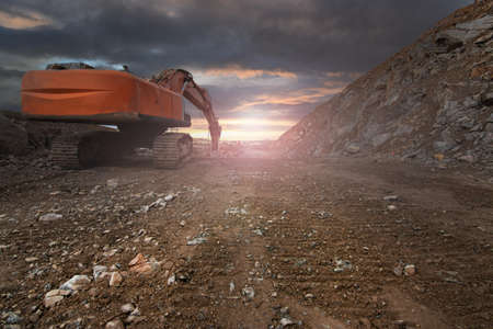 Excavator with hydraulic hammer on road construction works Stock fotó