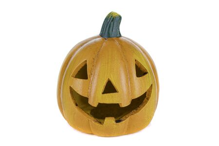 Ceramic orange pumpkin with eyes, nose and isolated mouth on a white background. Halloween concept. 版權商用圖片