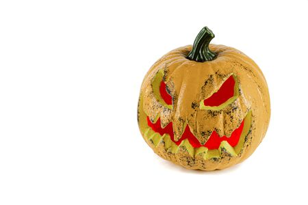 Big orange pumpkin with eyes and mouth with red light, isolated on a white background. Halloween concept.