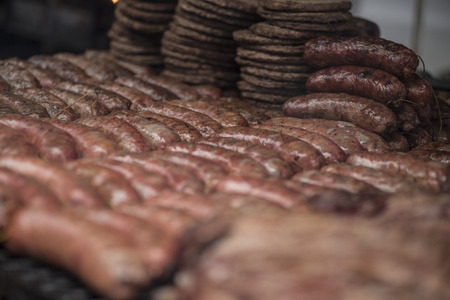 chorizos: Chorizos, a typical food in Argentina, in a grill Editorial