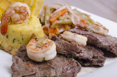 beef with salad, shrimp, rustic potatoes and chimichurri