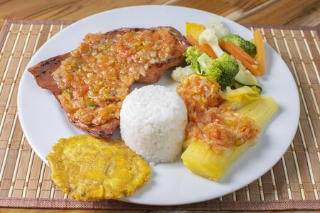 meat with fried cassava, salad and rice