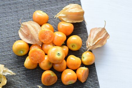 fresh whole gooseberries, shelled and sliced, displayed in containers