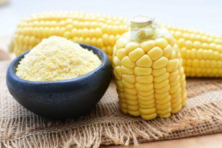 yellow sweet corn (cob) and green husk, chopped and shelled corn