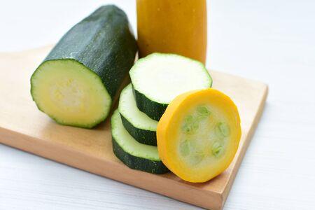 Cucurbita pepo - Zuquini, Pumpkins, zucchini, whole and cut yellow and green in white background