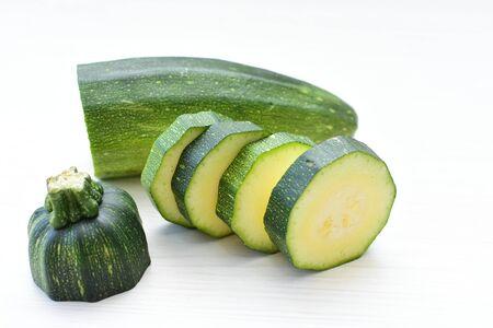Cucurbita pepo - Zuquini, pumpkins, zucchini, whole and cut green in white background