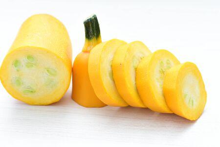Cucurbita pepo - Zuquini, Pumpkins, zucchini, whole and cut yellow in white background