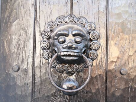 Knockers on the old gates of the walled city, different metal materials in the city of Cartagena de Indias - Colombia