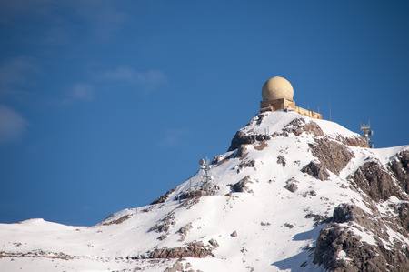 enforced: Military basis with a radar on top of a mountain Stock Photo