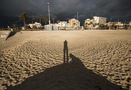 labrador teeth: Photograph photographers shadow and his dog on a beach in Majorca