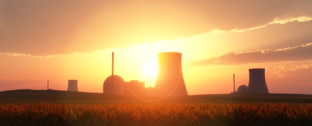 power: nuclear power plants in a wheat field and sunset