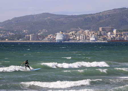 palma: surfer in Palma Harbor, spain