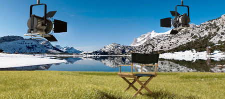 director's chair: cuber water reservoir in the Tramuntana mountains in Majorca and spotlights and directors chair Stock Photo