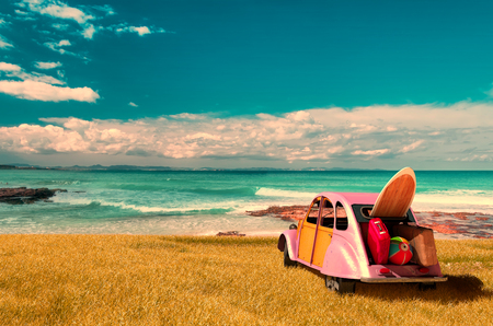 panoramic beach: vintage sunny day and holidays car in formentera beach, spain